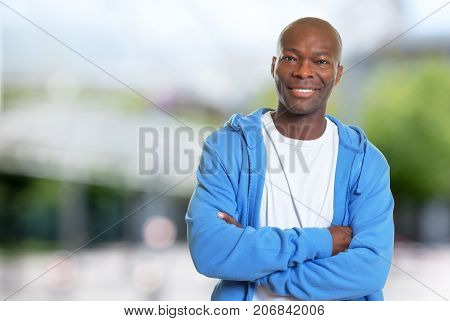 Laughing african american man with hoodie after workout