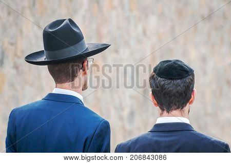 Two adult Hasidim in traditional Jewish headdresses hat and kippah. Prayer of Hasidim.