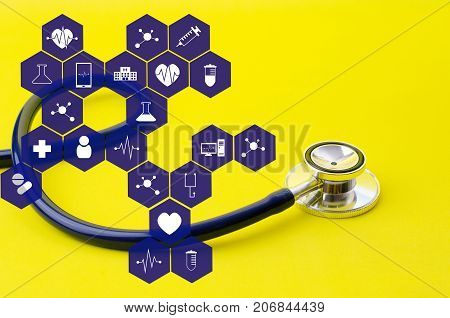 stethoscope on yellow background with medical icon in hexagon pattern heart health care laboratory science chemical and medical research concept