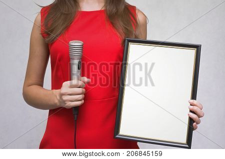 Congratulatory speech. Grateful letter. Gratitude concept. Accolade. Thank letter. Special offer. Young woman in red dress holding in hands empty blank photo frame. Appreciation document. The winner.