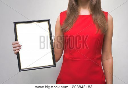 Grateful letter. Gratitude concept. Accolade. Thank letter. Special offer. Young woman in red dress holding in hands empty blank photo frame. Appreciation document. The winner.