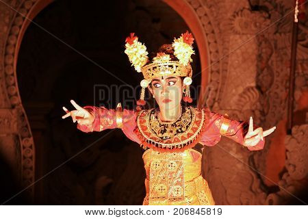 BALI, INDONESIA - AUGUST 20, 2017 - Balinese girl performs the typical barong dance in a show in Ubud