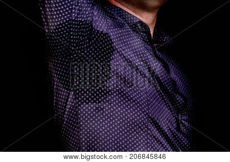 Man With Sweating Under Armpit Isolated On Black