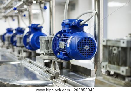 A number of electric motors with reducers. Tanks for mixing liquids. Food industry.