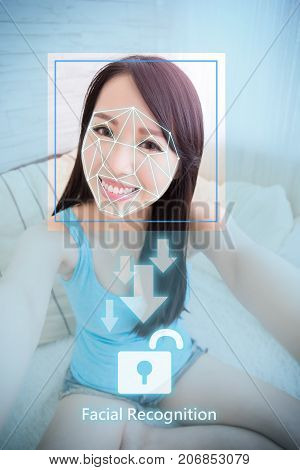 young woman is taking selfie for facial recognition concept