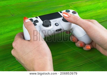 Sankt-Petersburg Russia September 24 2017: Sony PlayStation 4 dualshock game controller in gamers hand on white background studio shot.
