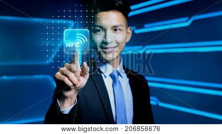 businessman touch nfc icon on blue background
