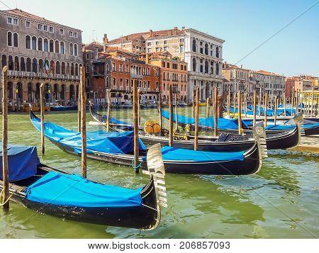 VENICE, ITALY - SEPTEMBER 4, 2013: Gondolas moored on Grand Canal in Venice, Italy