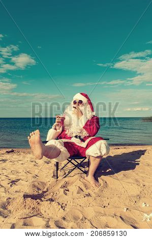 Santa Claus Is Resting On The Beach.