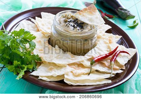 Light dietary pate from eggplant. Baba ganush is an Asian dish. Serve with thin lavash on a ceramic bowl.