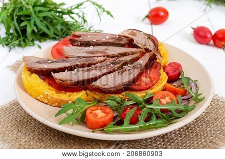Useful sandwiches: goose breast on pumpkin bread salad from tomatoes arugula red onions.