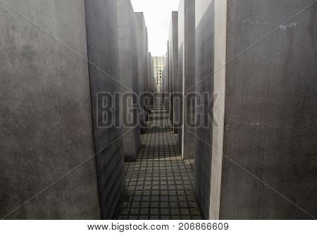 Berlin, Germany: May 20, 2015: Memorial to the Murdered Jews of Europe. View along the granite illars of the Holocaust Memorial in Berlin.