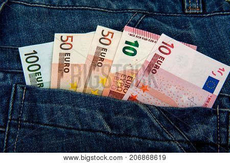 money in a jeans pocket, euro, pocket with money