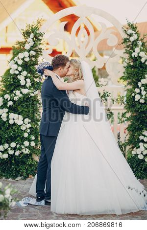 wedding ceremony vows the newlyweds in a beautiful arch