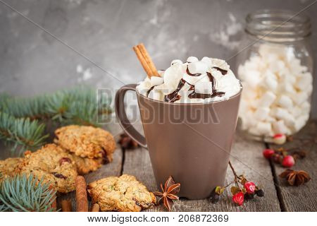 Hot Christmas cacao with marshmallow in the New Year decorations.