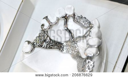 example of a bridge on an artificial human jaw close-up