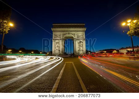Paris Arc de Triomphe Triumphal Arch at Chaps Elysees at night, Paris, France. Architecture and landmarks of Paris. Postcard of Paris