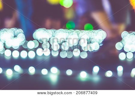 Blurred Background,low Angle View Of People Walk At Night Event Fair With Bokeh Light