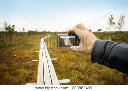 Big swamp wetlands Kemeri national park Latvia. Person shoots a landscape with the camera. Travel concept