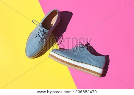 Top view of trendy woman shoes on bright background.