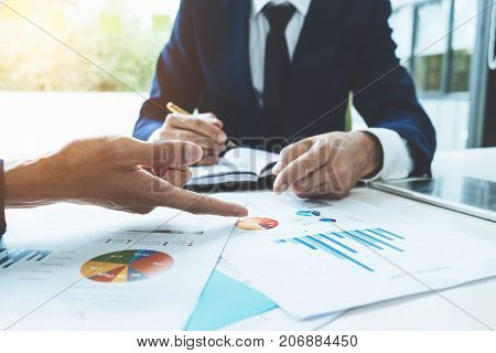 Business Advisor Analyzing Financial Figures Denoting The Progress In The Work Of The Company