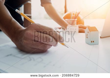 Image Of Engineer Drawing A Blue Print Design Building Or House At His Office