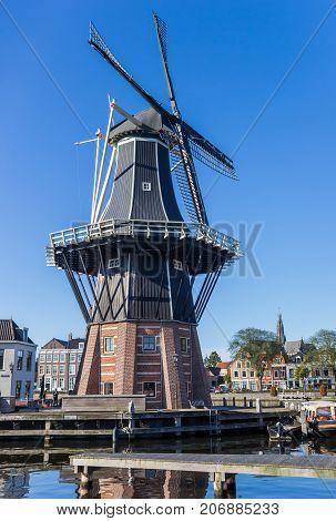 HAARLEM, NETHERLANDS - SEPTEMBER 03, 2017: Historic windmill Adriaan in the center of Haarlem Netherlands