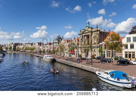 HAARLEM, NETHERLANDS - SEPTEMBER 03, 2017: Canal with boats and old houses at the Spaarne in Haarlem Netherlands