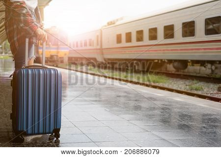Pretty Woman Hipster Waiting The Classic Train And Holding Blue Suitcase At Train Station For Travel