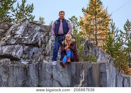 Family Travelers Looking At A Mountain Lake In Marble Canyon.