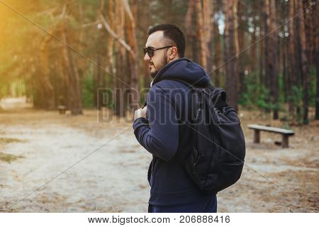 Hiker - Man Hiking In Forest. Male Hiker In Glasses In Forest. Caucasian Male Model Outdoors In Natu
