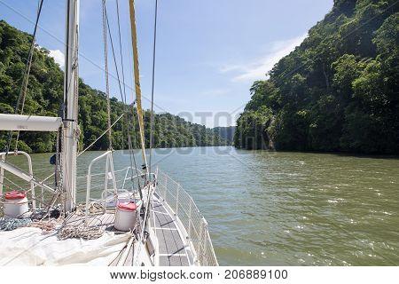 Rio Dulce Guatemala with a sailing boat