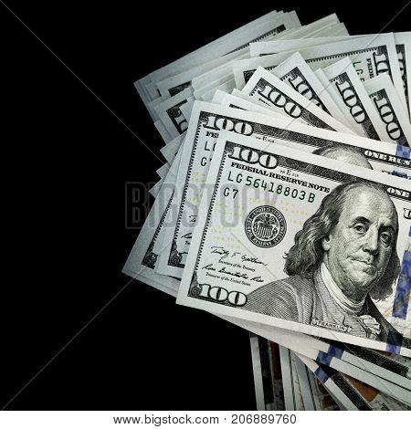 Bundle Of One Hundred Dollars Isolated On Black