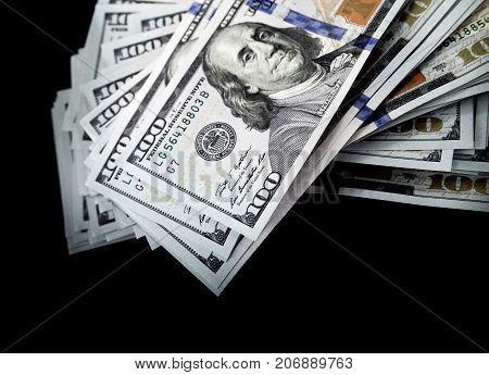 One Hundred Dollars Isolated On Black Background