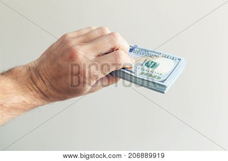 Bundle Of One Hundred Us Dollars Notes In Hand