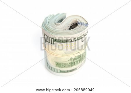 Roll Of One Hundred Dollars Stands On White