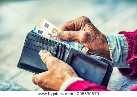 Pensioner Man Holding In Hands Wallet With Money