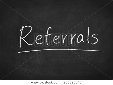 referrals concept word on a blackboard background