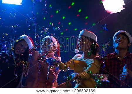 Young Asian group man and women dancing new year christmas pary in midnight december at nightclub countdown luxury