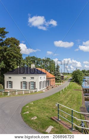 Old house and rural road in Groningen Netherlands