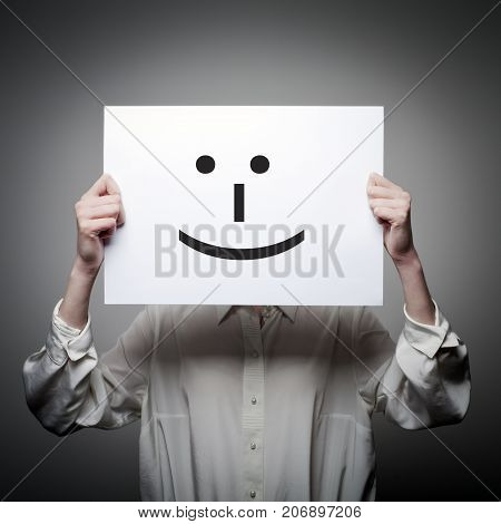 Woman is holding white paper with smile. Happy concept.
