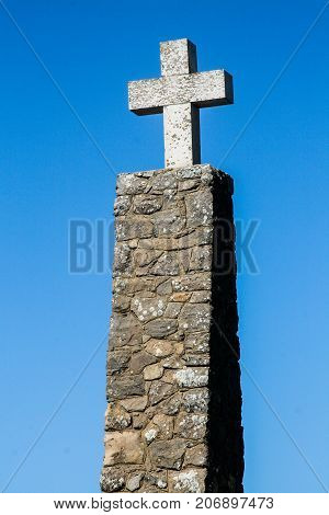 Cross against Blue Sky at Cabo da Roca, Portugal, Europe's most westerly point.