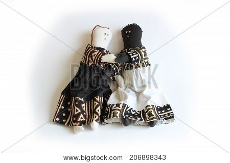Black doll and white doll holding hands concept inclusion, racial harmony, togetherness, isolated on white