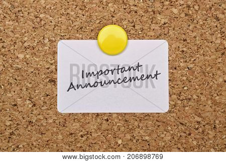 Text Important Announcement on a sticker pinned on cork