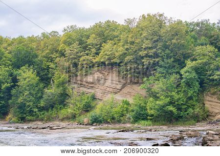 Sandstone Outcrops In The Steep Bank Of The River.