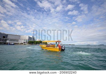 KOTA KINABALU MALAYSIA- 24 JUN 2017: View of tourist boats at Jetty Jesselton Point Kota Kinabalu Sabah. This jetty provided tourists facilities to the islands in Tunku Abdul Rahman Marine Park nearby.