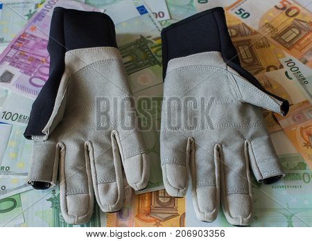 Gloves For Sailing Against The Background Of Euro Banknotes.