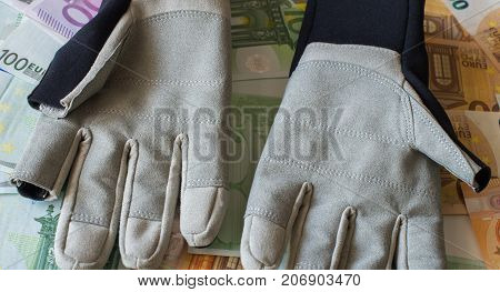 Protective Gloves For Sailing Against The Background Of Euro Banknotes.