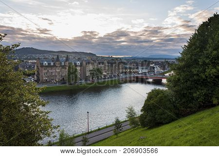Inverness Scotland - August 14 2010: View of the city of Inverness from the banks of the Ness River in Scotland United Kingdom