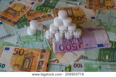 A Bunch Of Salt Tablets On The European Money